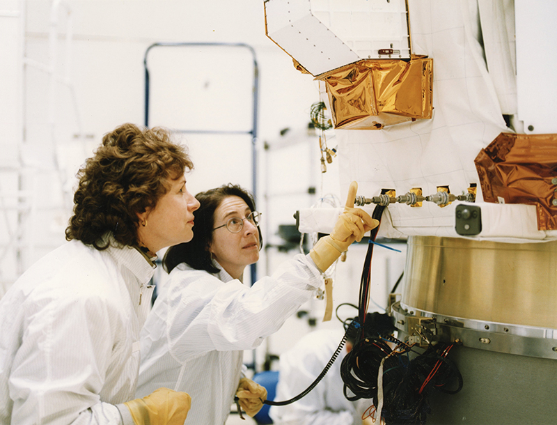 APL project manager Mary Chiu (right) and systems engineer Judi von Mehlem with the ACE spacecraft.