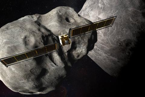 Rendering of the DART spacecraft behind two asteroids
