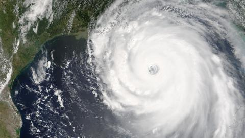 Satellite image of a hurricane over water near a coastline