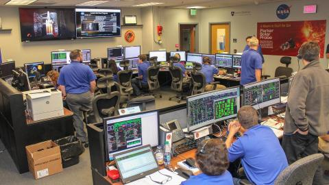 APL staff working in APL's mission control room