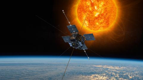 Rendering of one of the Van Allen Probes orbiting above Earth with the Sun in background