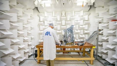Scientist running electromagnetic tests on Lucy LORRI in APL's anechoic chamber