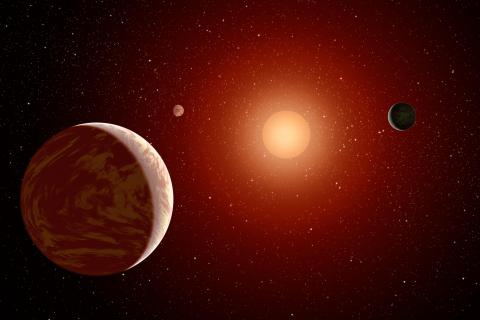 Artist's depiction of a red, M-dwarf star with three exoplanets orbiting it. (Credit: NASA/JPL)