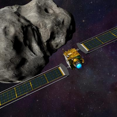 DART spacecraft approaching its target asteroid Dimorphos, with LICIACube watching from right