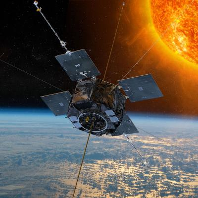 Rendering of the Van Allen Probes orbiting above Earth with the Sun in background